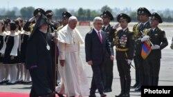 Armenia - President Serzh Sarkisian and Catholicos Garegin II greet Pope Francis on his arrival at Yerevan airport, 24Jun2016