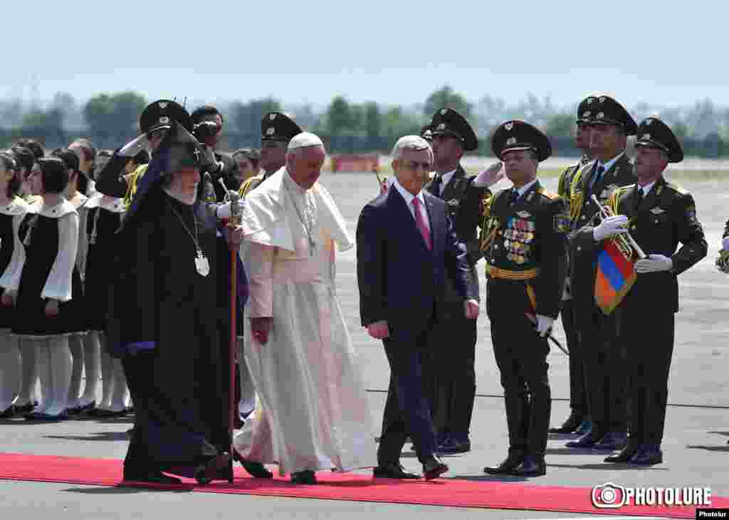 Armenia - President Serzh Sarkisian and Catholicos Garegin II greet Pope Francis on his arrival at Yerevan airport, 24Jun2016