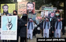 Afghans protest the release of Taliban prisoners in November 2019 in Kabul.