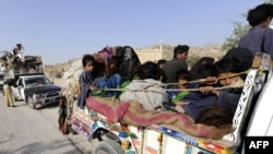 Displaced families flee from military operations against Taliban militants in South Waziristan.