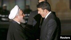Iranian President Hassan Rohani (left) shakes hands with Italian Prime Minister Matteo Renzi in Rome on January 25.