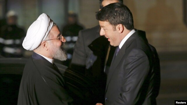 Iranian President Hassan Rohani (left) shakes hands with Italian Prime Minister Matteo Renzi in Rome on January 25.