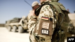A German soldier wears a badge with his blood type as he prepare to depart on a multi-day patrol in Kunduz.