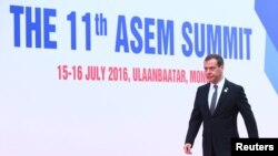 Russian Prime Minister Dmitry Medvedev arrives for the 11th Asia-Europe Meeting (ASEM) in Ulan Bator, Mongolia on July 15.