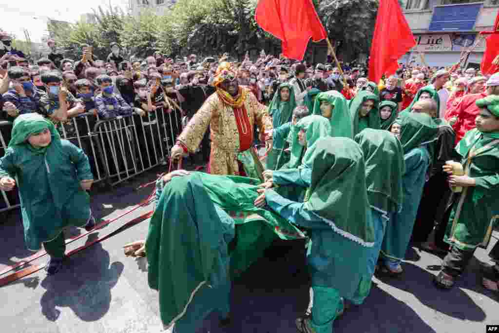 Children perform a reenactment on the 10th day of the month of Muharram, which marks the peak of Ashura.