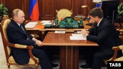 Russian President Vladimir Putin (left) meets with Kadyrov at the Kremlin on August 25.