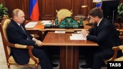 Russian President Vladimir Putin (left) meets with Kadyrov at the Kremlin on August 25.