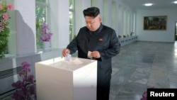 North Korean leader casts his vote in a previous election (file photo).