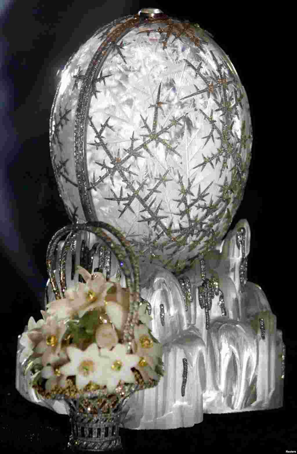 Over the next three decades, Carl Faberge would create another 49 eggs for Russia's last two tsars. Pictured is the Winter Egg, one of his most famous, crafted from rock crystal and etched with platinum and diamonds to resemble frost. The 14-centimeter egg opens to reveal a bejeweled basket of spring flowers.