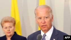 Lithuanian President Dalia Grybauskaite (left) and U.S. Vice President Joe Biden addressing a joint press conference after the their meeting in Riga on August 23.