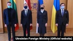 Ukrainian Foreign Minister Dmytro Kuleba (right) poses with Lithuanian Foreign Minister Gabrielius Landsbergis, (from left) Latvian Foreign Minister Edgars Rinkevics, and Estonian Foreign Minister Eva-Maria Liimets in Kyiv on April 15.
