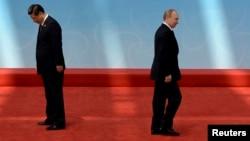 Қытай президенті Си Цзиньпин мен Ресей президенті Владимир Путин. Шанхай, 21 мамыр 2014 жыл.