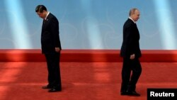 Российский и китайский лидеры на прошлогодней встрече в Шанхае