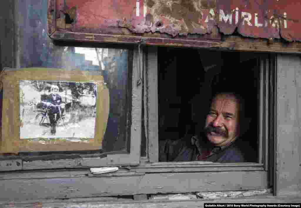 Photographer Gultekin Alkurt of Turkey: My Childhood This man lives in Istanbul, at Karakoy, in a tiny cabin left to him by his father. He can still smile despite the restricted living conditions.