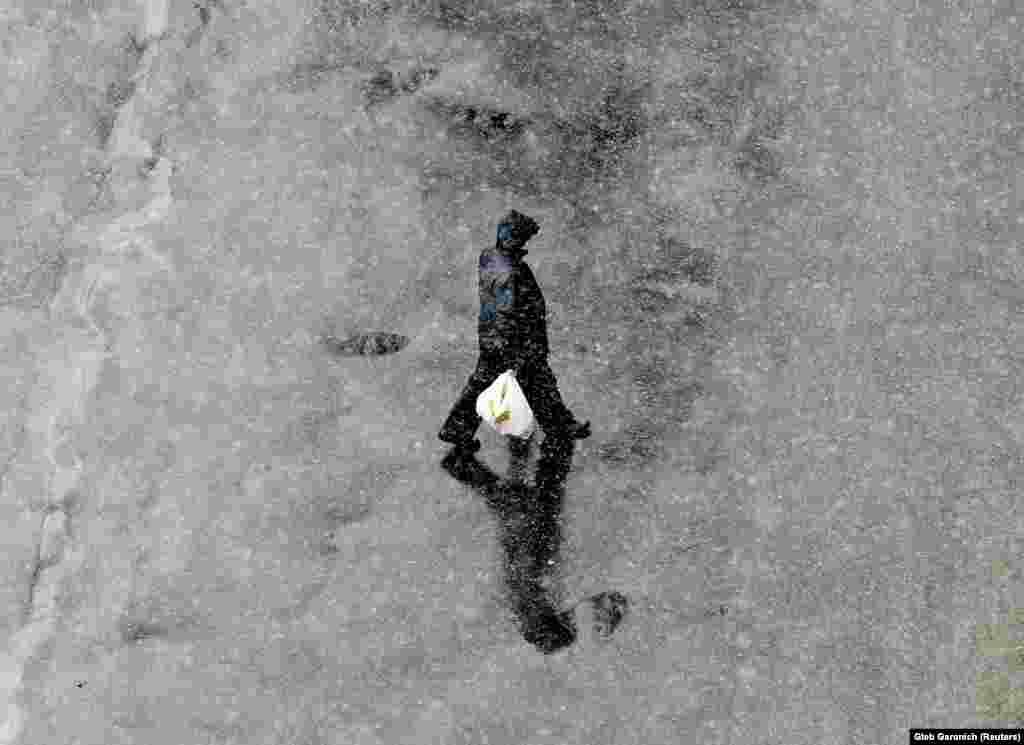 A man walks during a snowfall in Kyiv. (Reuters/Gleb Garanich)