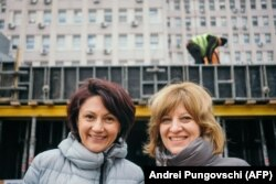 The co-founders of Daruieste Viata -- Oana Gheorghiu (right) and Carmen Uscatu -- pose at the construction site of the new hospital in Bucharest in December 2018.