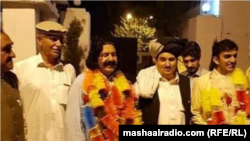 Ali Wazir (second left) and Mohsin Dawar (right), pictured after their release from jail, are members of a Pashtun civil rights movement.