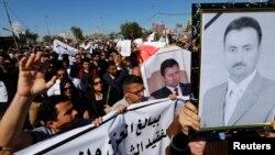 Акция протеста журналистов Ирака против убийства Мохаммеда Бдайви Овайда аль-Шаммери. Багдад, 23 марта 2014 года.