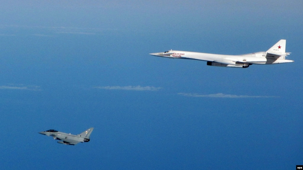 An Raf Typhoon Fighter Aircraft Left Flies Close To A Russian Strategic Tupolev Tu