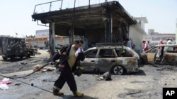 Firefighters work at the site of a deadly suicide attack in Jalalabad, the capital of Nangarhar Province, on July 10.