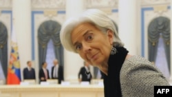 International Monetary Fund Managing Director Christine Lagarde takes her seat waiting for Russian President Vladimir Putin during a meeting of G20 finance ministers in the Kremlin in Moscow on February 15.