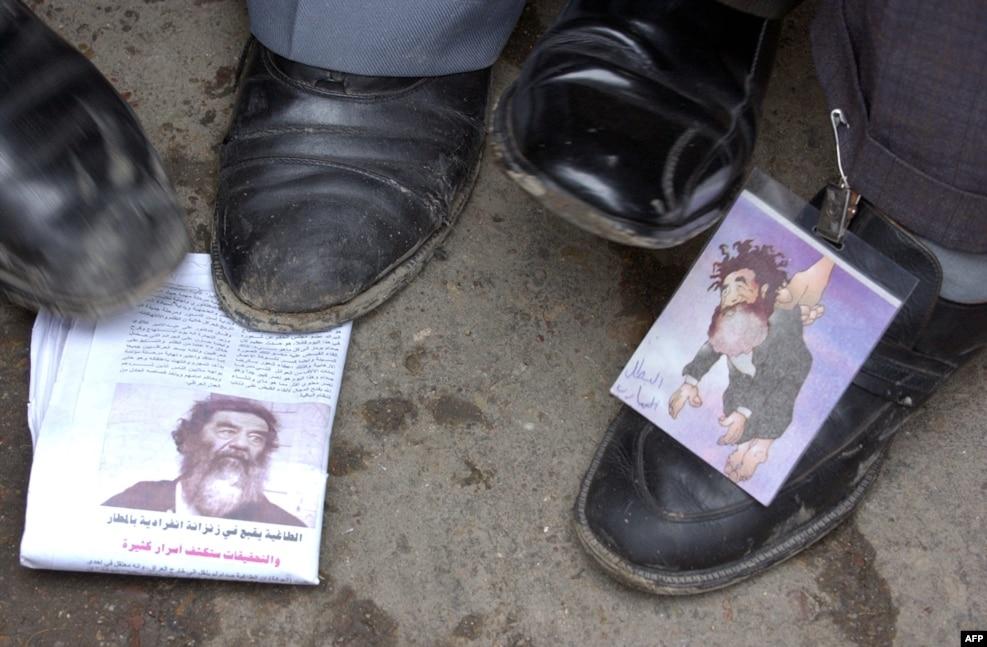 تصاویر صدام در روزنامههای عراقی، پس از بازداشت او.