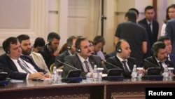 Сирия оппозициясынын делегациясы Астана сүйлөшүүлөрүнүн бешинчи айлампасында. 5-июль, 2017-жыл.