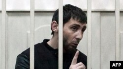 Zaur Dadayev, charged with the murder of Russian opposition figure Boris Nemtsov, speaks inside a defendants' cage at the Basmanny district court in Moscow on March 8.