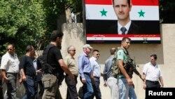 БҰҰ-ның химиялық қару жөніндегі сарапшылар тобы Дамасктегі әскери госпитальге бара жатыр. Сирия, 30 тамыз 2013 жыл.