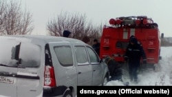 Ukraine -- Rescuers pull the bus out of the snow, Odesa region