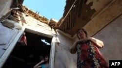 Разрушенный в ходе боевых действий жилой дом в Славянске