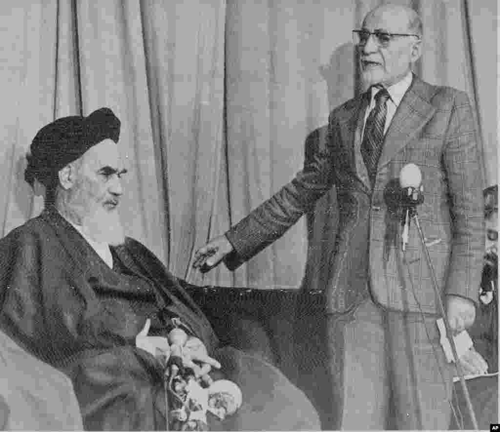 Mehdi Bazargan, newly named Prime Minister of a provisional government in Iran, right, speaks with Khomeini on February 5, 1979.