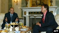 Russian President Vladimir Putin (left) speaks with Paul McCartney during their meeting at the Kremlin in Moscow in 2003.