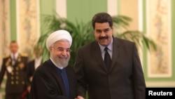 Президент Ирана Хасан Роухани (слева) и президент Венесуэлы Николас Мадуро