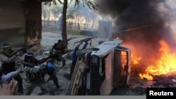 Сирийские повстанцы во время наступления правительственных войск в Алеппо, октябрь 2013 года.