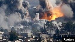 Айрым бир бөлүгүн согушкерлер ээлеп алган Сириянын Кобани шаары.