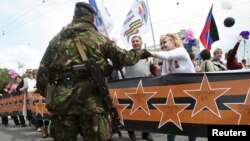 Святкове дійство на честь першої річниці псевдореферендуму, організоване угрупованням «ДНР», що визнне в Україні терористичним. Донецьк, 11 травня 2015 року