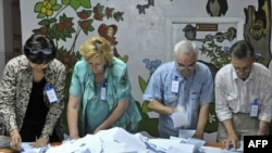 Election officials count votes at a polling station in Bishkek during a 2009 ballot in Kyrgyzstan.