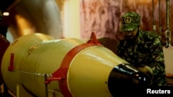 A member of IRGC checks a missile inside an underground depot at an undisclosed location in this handout photo released by the official website of IRGC, March 8, 2016