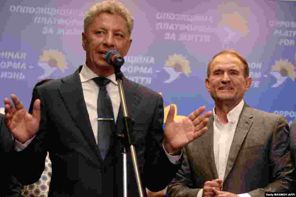 Ukraine's Opposition Platform-For Life party leaders Viktor Medvedchuk and Yuriy Boyko give a speech at the party's election headquarters in Kyiv. Early exit polls showed their party, which is pushing for better ties with Russia, was on track to come in second with 11.5 percent of the vote. (AFP/Vasily Maximov)