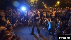 Armenia - An activist addresses protesters on Marshal Bagramian Avenue, 30Jun2015.
