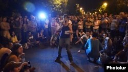 Armenia - An activist addresses protesters on Marshal Bagramian Avenue, 30Jun2015.