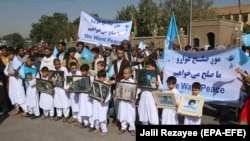 Afghans attend a rally in Herat to support the Doha peace talks between the Taliban and the Afghan government on September 21.