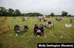 British fans wait for the beginning of the ABBA Mania concert at Scampston Hall in Malton, Yorkshire, on August 29.