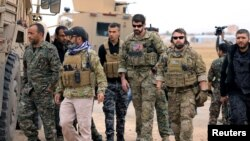 U.S. troops and Syrian Democratic Forces patrol near the Turkish border with Syria (file photo).