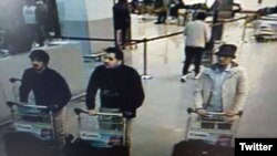 This police photo shows the two suspected suicide bombers in the airport attacks and an unidentified third man, at right.