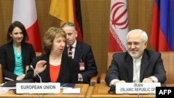 EU foreign policy chief Catherine Ashton (second from left ) and Iranian Foreign Minister Javad Mohammad Zarif (right) attend the last day of the EU 5+1 Talks with Iran at the UN headquarters in Vienna on February 20.
