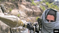 A Pakistani Taliban wields a rocket-propelled grenade launcher near Buner in mid-April.
