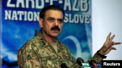 Lieutenant General Asim Bajwa, the Pakistani military's top spokesman, speaks during a news conference in Rawalpindi on September 1.