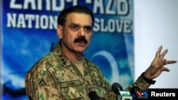 Lieutenant General Asim Bajwa, then the military's top spokesman, speaks during a news conference in Rawalpindi in September 2016.